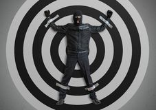 Thief or burglar masked with balaclava is caught and is taped to the target with duct tape. Royalty Free Stock Images