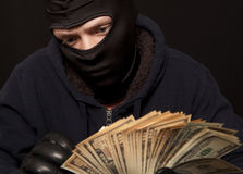 Thief and cash Stock Images