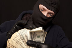 Thief and cash Stock Photo