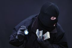 Thief commits a crime. Sensed danger Stock Photo