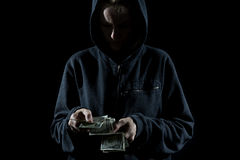 Thief Counting the Cash Royalty Free Stock Photos