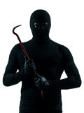Thief criminal holding crowbar portait. In silhouette studio isolated on white background Stock Image