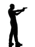 Thief criminal terrorist aiming gun man silhouette Stock Photography