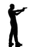 Thief criminal terrorist aiming gun man silhouette. Thief criminal terrorist man aiming gun in silhouette studio isolated on white background stock photography