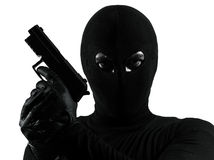 Thief criminal terrorist holding gun portrait Stock Images