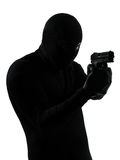 Thief criminal terrorist holding gun portrait Royalty Free Stock Photo