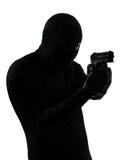 Thief criminal terrorist holding gun portrait Royalty Free Stock Photo