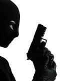 Thief criminal terrorist holding gun portrait Stock Image