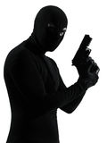 Thief criminal terrorist holding gun portrait Royalty Free Stock Image