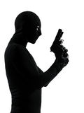 Thief criminal terrorist holding gun portrait Stock Photography