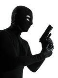 Thief criminal terrorist holding gun portrait silhouette Stock Photo