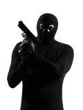 Thief criminal terrorist holding gun portrait silhouette Stock Photos