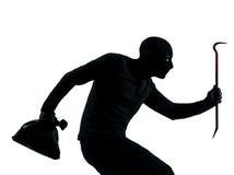 Thief criminal walking quiet silhouette. Thief criminal walking quiet in silhouette studio isolated on white background Stock Photo