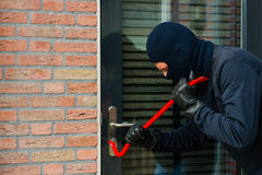 Thief with a crowbar Stock Photo