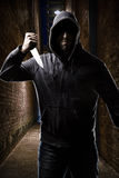 Thief on a dark alley Stock Photos