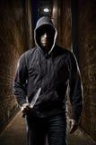 Thief on a dark alley. Thief in the hood on a dark alley stock photos