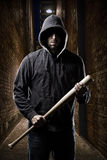 Thief on a dark alley. Thief in the hood on a dark alley stock image
