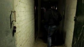 Thief in dark cellar stock video
