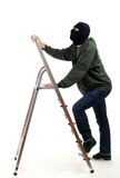 Thief entering on ladder Royalty Free Stock Photos