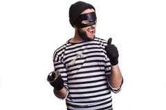 Thief escape from a jail. Portrait isolated on white background Royalty Free Stock Photos