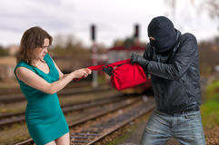 Thief is fighting with woman and stealing handbag. Thief is fighting with women and stealing handbag stock photo