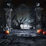 Thief in the garden. Horror scenery with zombie, pumpkins and old garden gate Royalty Free Stock Photography
