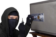 A thief getting the key Royalty Free Stock Images