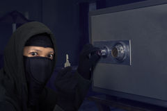 A thief getting the key 1 Royalty Free Stock Photo