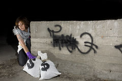Thief getting money sack Royalty Free Stock Photography
