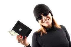 Thief girl holding a safe Royalty Free Stock Images