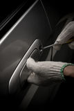 Thief with glove trying to open a vehicle door by screw driv Royalty Free Stock Photography