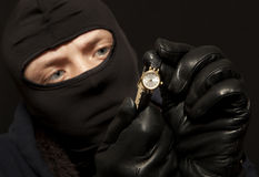 Thief with a golden watch Stock Photos