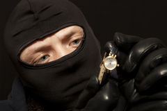 Thief with a golden watch Stock Photo