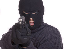 Thief with gun. Aiming into a camera - isolated on white background Stock Photos