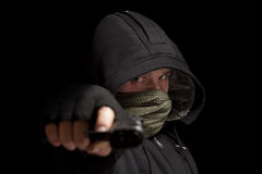 Thief with gun. Aiming into a camera stock images