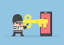 Thief or hacker hacking. Smartphone by key Stock Photography