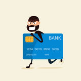 Thief. Hacker stealing sensitive data and money from credit card. Useful for anti phishing and internet viruses campaigns. Stock Photography