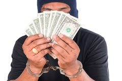 Thief hand in handcuffed hold money Royalty Free Stock Image