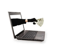 Thief hand with money from a laptop screen Stock Photography