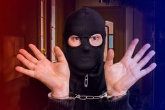 Thief in handcuffs - police arrested him Royalty Free Stock Image