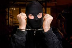 Thief in handcuffs - police arrested him. Near crime scene Stock Photography