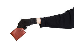 Thief holding a brown leather purse Royalty Free Stock Photography