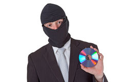 Thief holding a data disk Stock Photos
