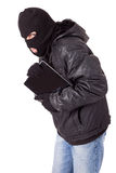 Thief holding a laptop Royalty Free Stock Images