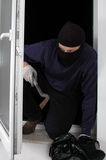 Thief at home Stock Photo