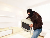 Thief in house Stock Images