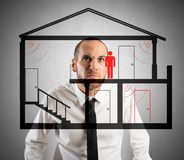 Thief in the house. Businessman controls the thief in the house Stock Images