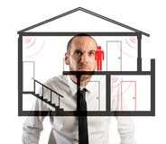 Thief in the house. Businessman controls the thief in the house Royalty Free Stock Images