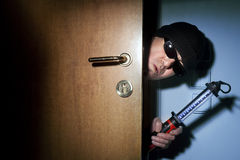 Thief in a house Stock Photography