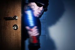 Thief in a house Royalty Free Stock Photography